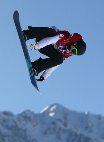 Maxence Parrot of Canada during his first run in heat two of the Men's Snowboard Slopestyle qualification at Rosa Khutor Extreme Park at the Sochi 2014 Olympic Games, Krasnaya Polyana, Russia